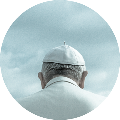 The back of the Pope's head against a grey sky.