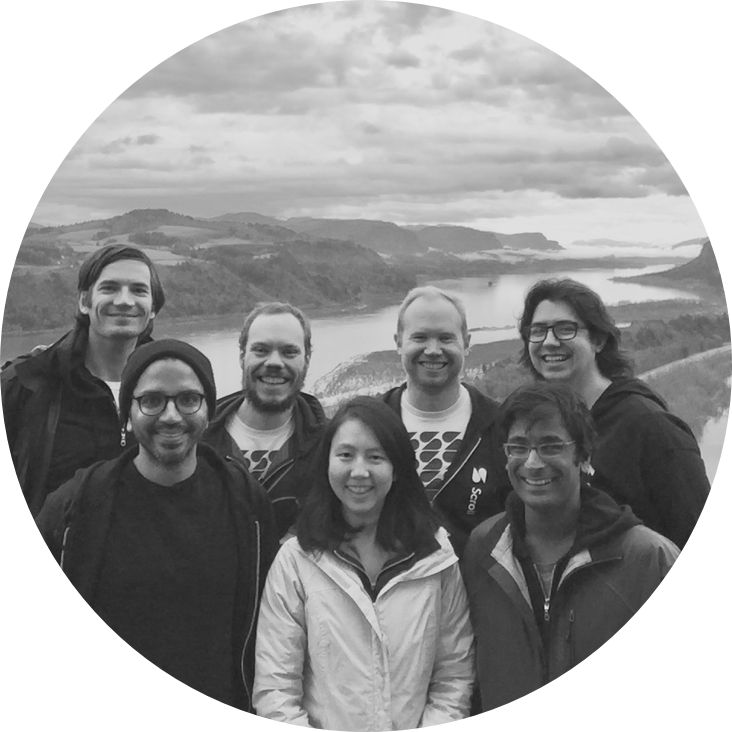 The Scroll team against the background of the Columbia Gorge, with mountains and a river.