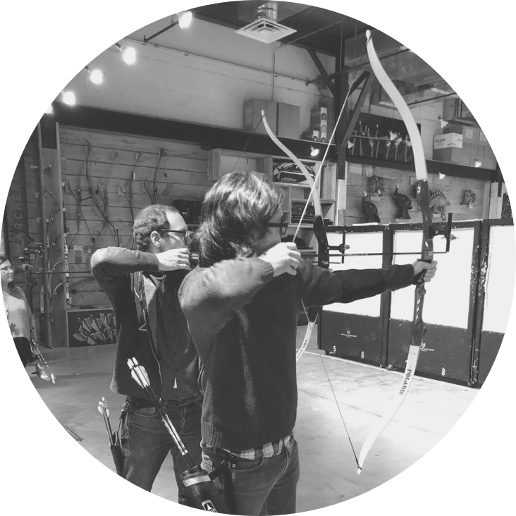 Members of the Scroll team practicing their archery skills.