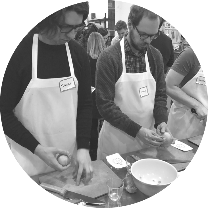 Members of the Scroll team chopping vegetables
