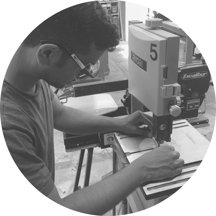 Member of the Scroll team cutting wood.